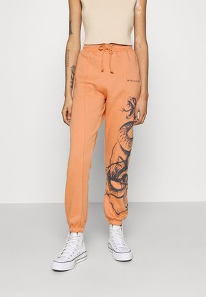 OVERSIZED 90S SNAKE - Tracksuit bottoms - orange