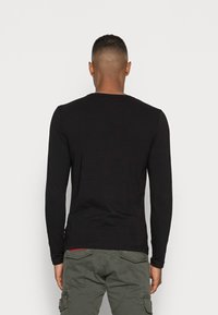 Tommy Hilfiger - STRETCH LONG SLEEVE TEE - Long sleeved top - black - 2