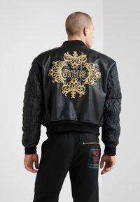 Versace Jeans Couture - GIUBBETTI UOMO - Bomberjacke - nero - 2