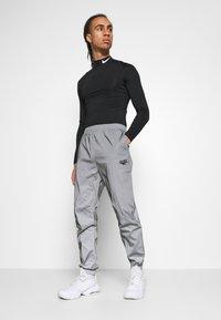 Hi-Tec - GRAHAM REFLECTIVE TRACK PANTS - Tracksuit bottoms - silver - 3
