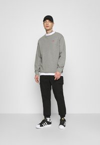 Tommy Jeans - JOGGER - Cargo trousers - black - 1