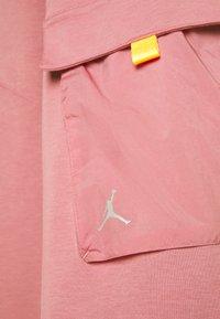 Jordan - Tracksuit bottoms - desert berry/laser orange/reflective silver - 5