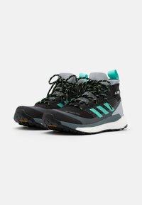 adidas Performance - TERREX FREE HIKER GORE-TEX - Hiking shoes - core black/active mint/hi-res yellow - 1