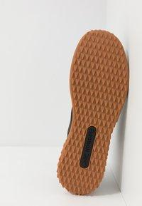 Reebok - TRAIL CRUISER - Trail running shoes - black - 4