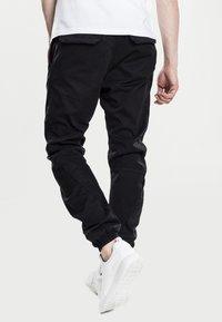Urban Classics - JOGGING - Cargo trousers - black - 1