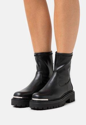ALIMA - Platform ankle boots - black