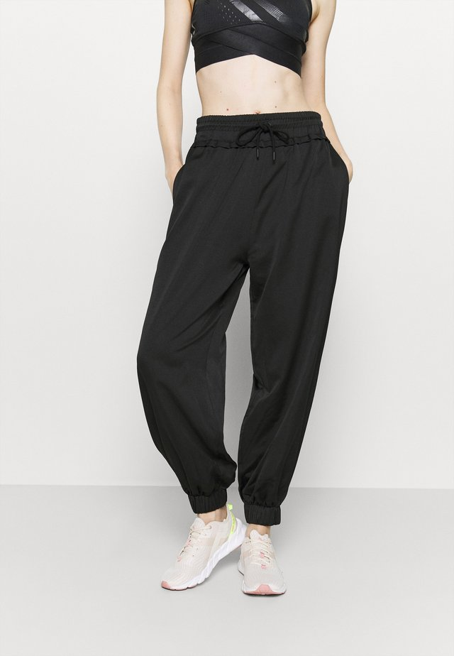 HIGH WAIST SEMI SHEER JOGGERS - Verryttelyhousut - black