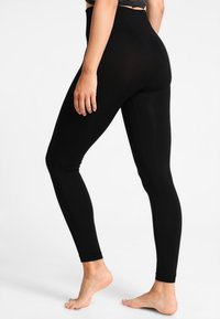 Filippa K - HIGH SEAMLESS LEGGING - Punčochy - black - 2