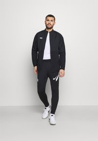 Nike Performance - PANT - Tracksuit bottoms - black/anthracite/white - 1