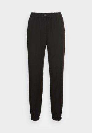 WOVEN JOGGER - Teplákové kalhoty - black
