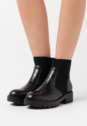 MIKA - Platform ankle boots - black