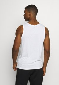 Nike Performance - TANK ATHLETE - Sports shirt - white/black - 2