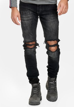 TOKIO - Slim fit jeans - black