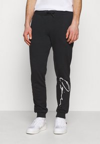 Jack & Jones - JORSCRIPTT PANTS  - Verryttelyhousut - black - 0