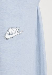 Nike Sportswear - PANT EARTH - Tracksuit bottoms - armory blue/heather/white - 6