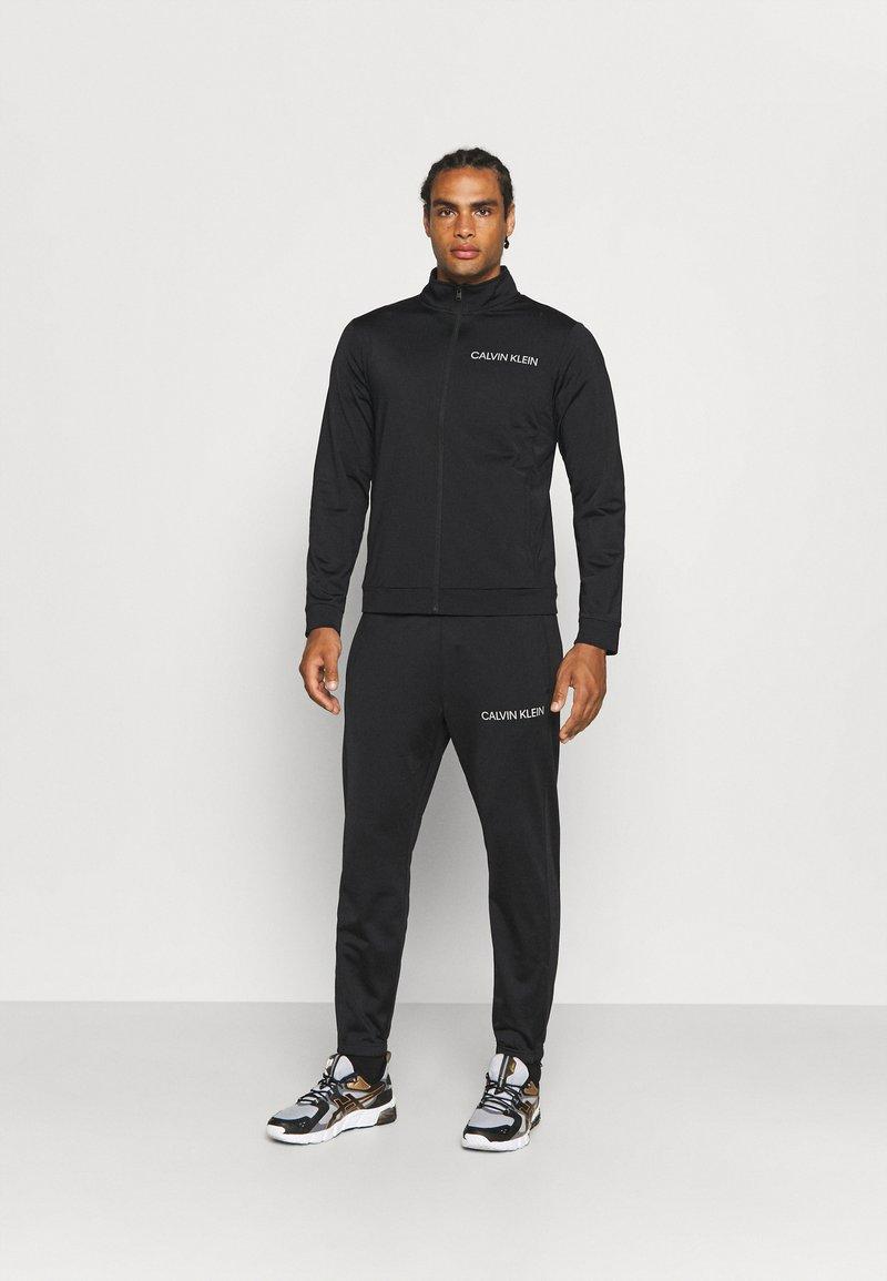 Calvin Klein Performance - TRACKSUIT - Tracksuit - black/bright white