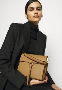Coccinelle - LOUISE - Handbag - warm beige/noir - 1