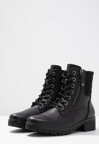 Jana - Šněrovací kotníkové boty - black - 4