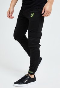 Illusive London Juniors - Trainingsbroek - black & green - 2