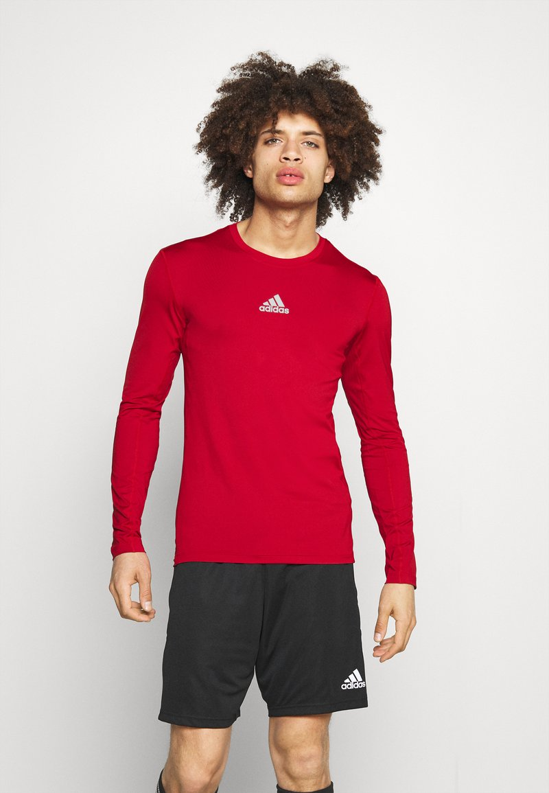 adidas Performance - TECH FIT - Funktionstrøjer - team power red