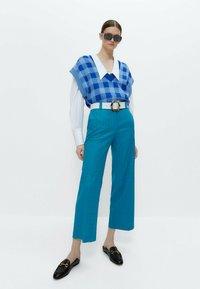 Uterqüe - MIT ZIERFALTEN - Button-down blouse - white - 1
