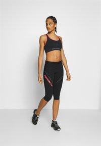 Dynafit - SPEED BRA - Light support sports bra - black out - 1