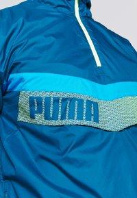Puma - TRAIN ZIP JACKET - Windjack - blue/fizzy yellow - 5