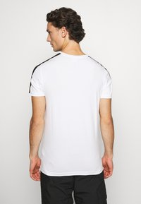 Puma - ICONIC SLIM - Sports shirt - white - 2