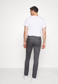 Tommy Hilfiger - BLEECKER FLEX SOFT  - Trousers - grey