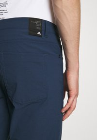 adidas Golf - GO TO FIVE POCKET PANT - Trousers - crew navy - 4