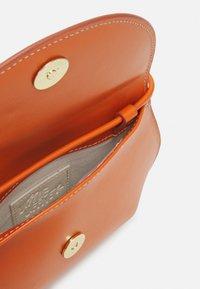 Little Liffner - PEBBLE MINI BAG - Across body bag - orange - 2