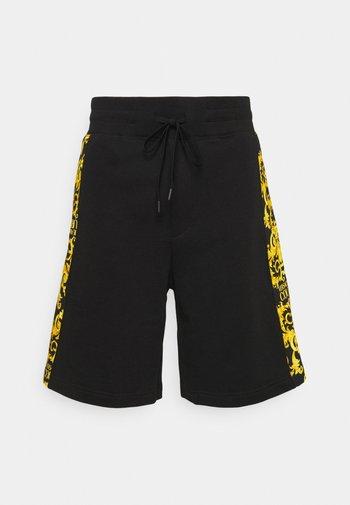 PRINT LOGO BAROQUE - Tracksuit bottoms - black