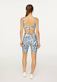 OYSHO - FLORAL PRINT  - Leggings - blue - 2