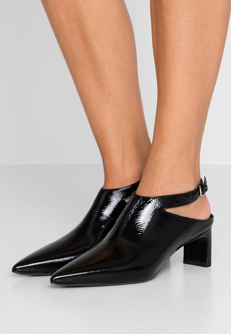 McQ Alexander McQueen - VISION OPEN BOOT - Ankle boots - black