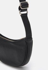 Becksöndergaard - SOFTY MINI MOON BAG - Across body bag - black - 3