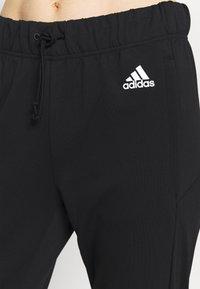 adidas Performance - Tracksuit bottoms - black/white - 3
