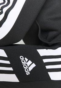 adidas Performance - SQUAD - Tracksuit bottoms - black/white - 4