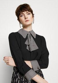 Elisabetta Franchi - 2-IN-1 - Áčková sukně - nero/burro - 3
