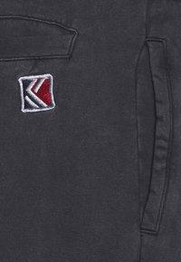 Karl Kani - SMALL SIGNATURE WASHED UNISEX - Pantaloni cargo - black - 2