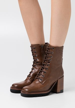 High heeled ankle boots - malaga cannella