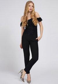 Guess - Trousers - schwarz - 1