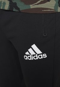adidas Performance - Pantalon de survêtement - black/white - 4