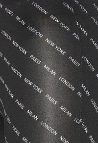 JDY - JDYBOURNE AOP - Leggings - black/city text - 2