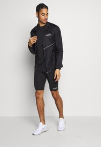 Diadora - LIGHTWEIGHT WIND JACKET BE ONE - Sports jacket - black - 1