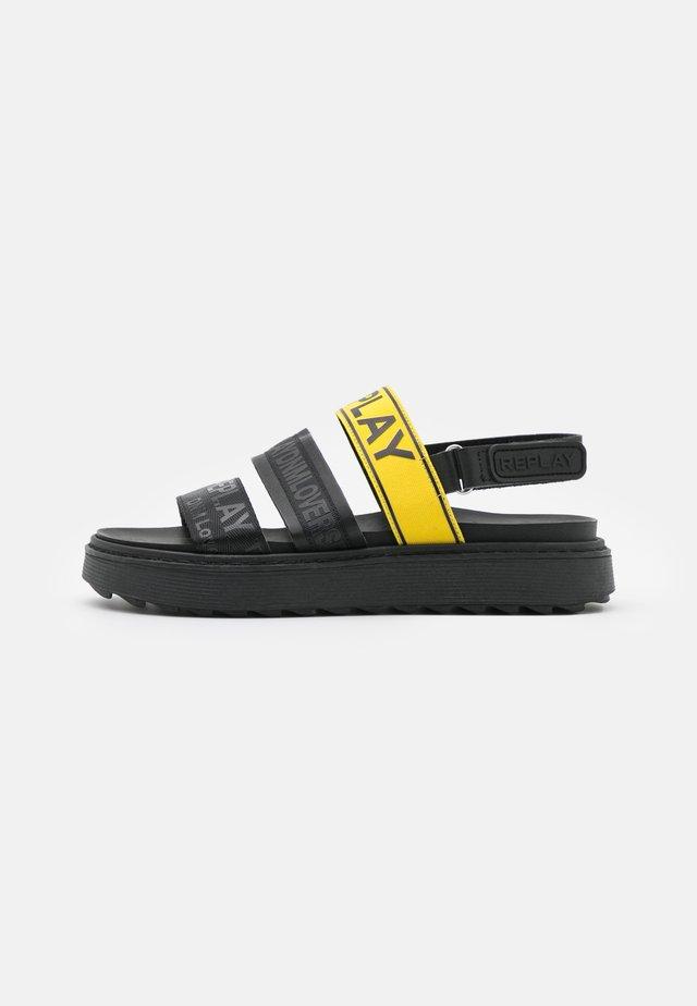 HURDVILLE - Sandalen met plateauzool - yellow/black