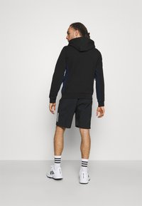 Lacoste Sport - TAPERED - Hoodie - black/navy blue - 2