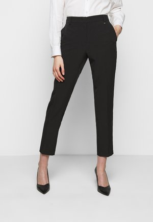 PANTALONE - Trousers - nero