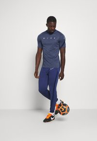 Nike Performance - DRY ACADEMY TOP - Print T-shirt - blue void/white - 1