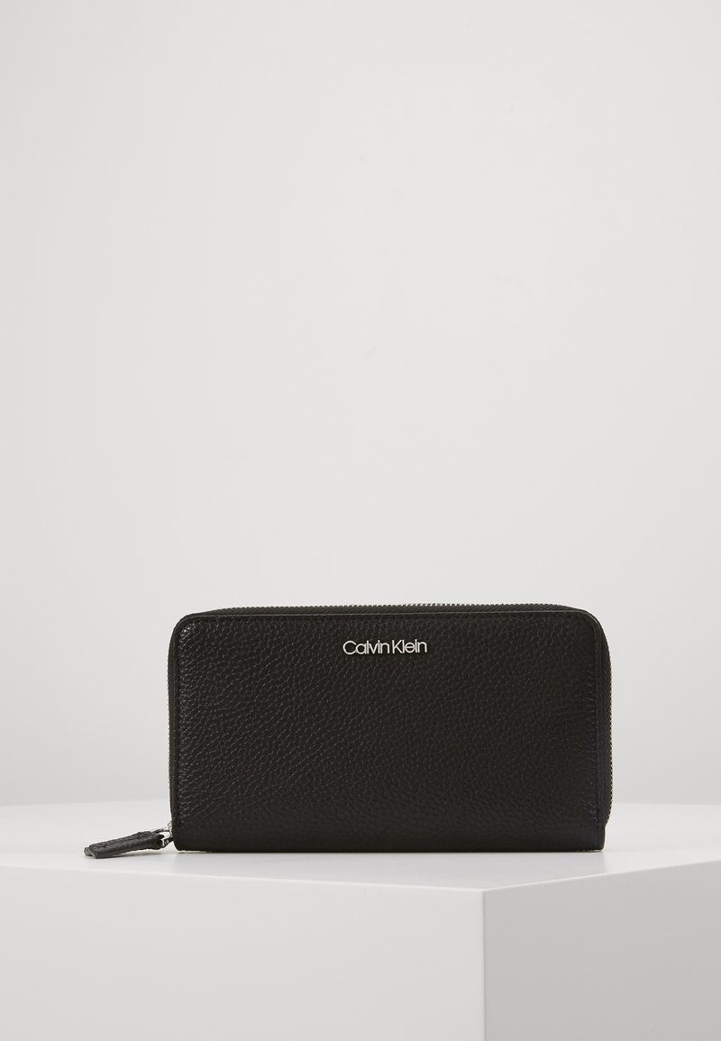 Calvin Klein - SIDED DOUBLE ZIPAROUND WALLET - Wallet - black
