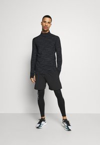 Endurance - ARTY REFLECTIVE MIDLAYER - T-shirt sportiva - black - 1